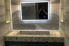 Condominium bathroom remodeling in Deerfield Beach with custom countertops on vanity