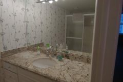 Dated master bathroom before renovations, view of vanity and miror
