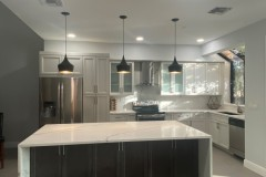 Kitchen island with cabinets and bar seating space