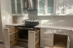 Custom cabinet installation with shelf and drawer interiors exposed