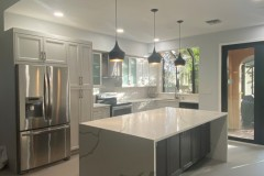 Pompano Beach kitchen after kitchen remodeling process, including waterfall kitchen island