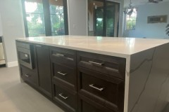 Kitchen island in Plantation, FL with cabinets and built in oven