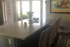 Kitchen island with seating in Coral Springs Condominium