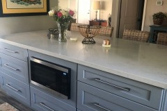Kitchen island with seating and built in microwave