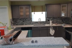 Gray cabinets and granite countertops after kitchen renovation in Coral Springs