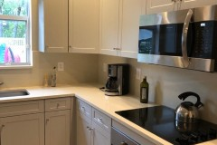 Stainless steel appliances in renovated kitchen