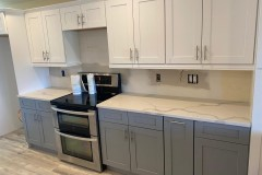 Two-tone kitchen cabinets in white and gray