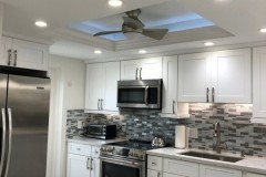 White kitchen cabinets, fan in drop ceiling, renovated in Fort Lauderdale