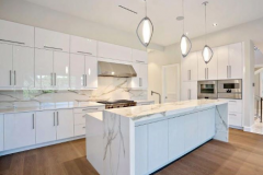 White marble kitchen remodeling in Plantation, FL, with warm brown wood floors