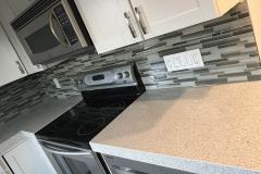 Kitchen remodel in Tamarac, FL featuring backsplash and kitchen countertop installation