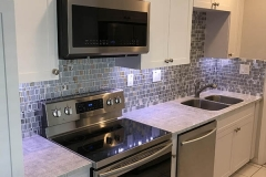 Custom kitchen countertops and backsplash after kitchen remodeling in Plantation