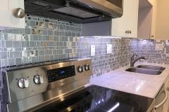 Close up of glass backsplash in remodeling kitchen in Plantation, FL