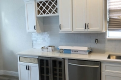 Galley kitchen with wine fridge