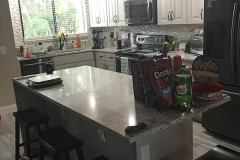 Condominium kitchen and bath remodeling with kitchen island in Deerfield Beach
