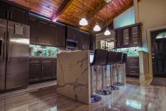 Kitchen island, bar seating, high ceiling kitchen design and renovation in Tamarac