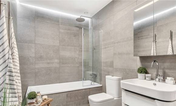 Bathroom remodeled in Pompano Beach, FL with slate gray accents