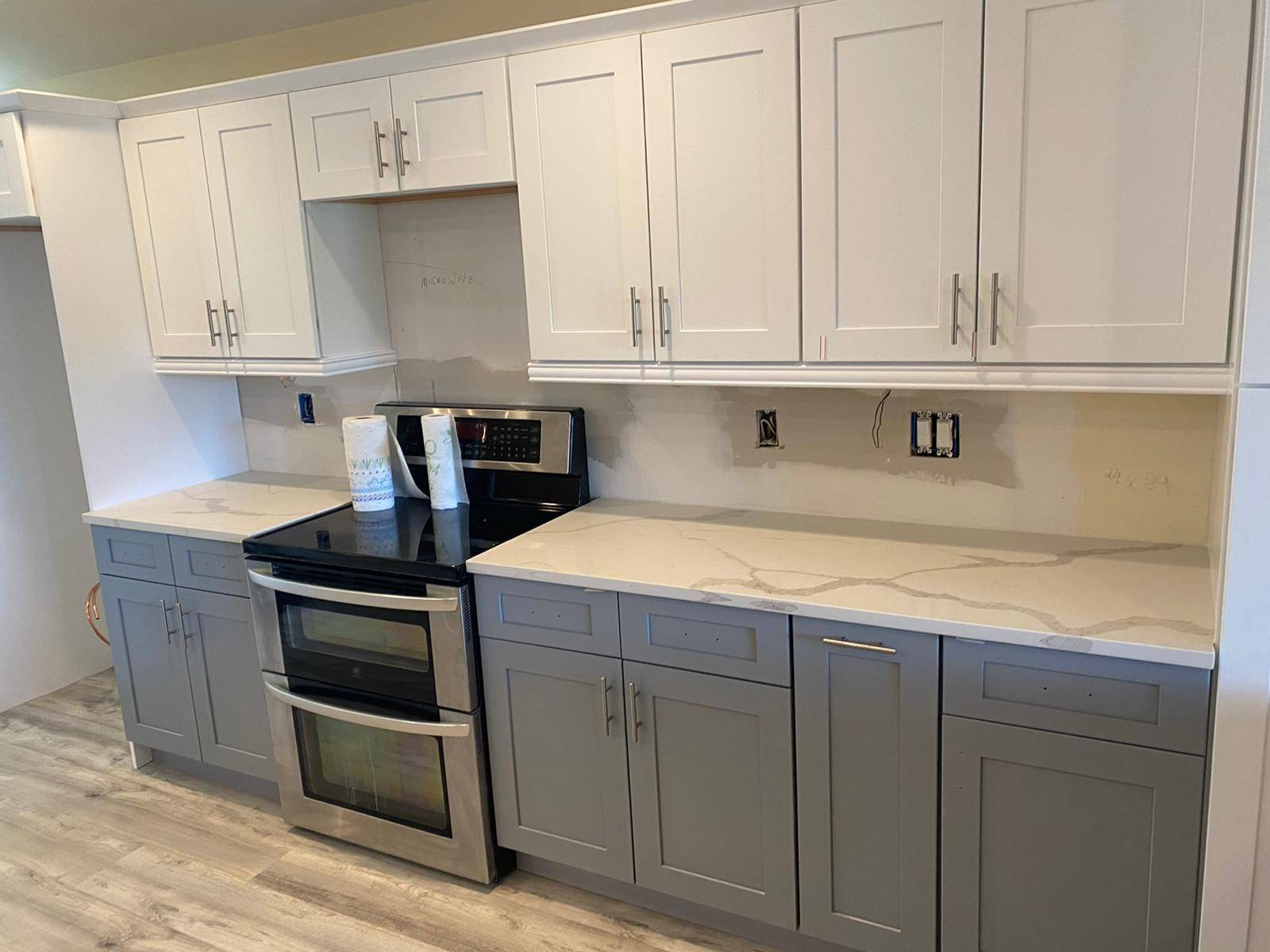 White and gray two-tone kitchen cabinets installed during Fort Lauderdale kitchen renovation