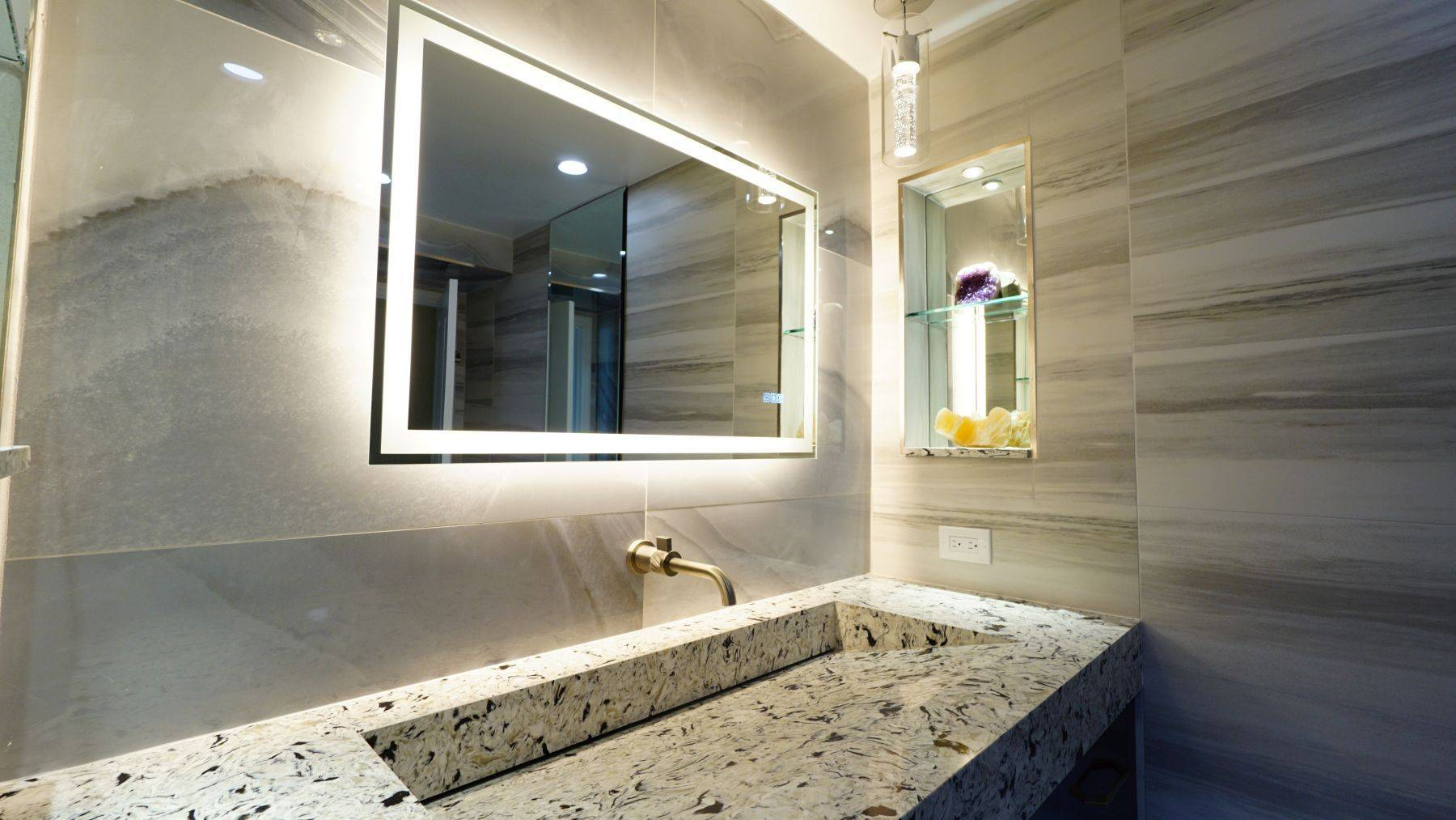 Granite sink with backlit mirror adding with Bathroom Remodeling in Pompano Beach