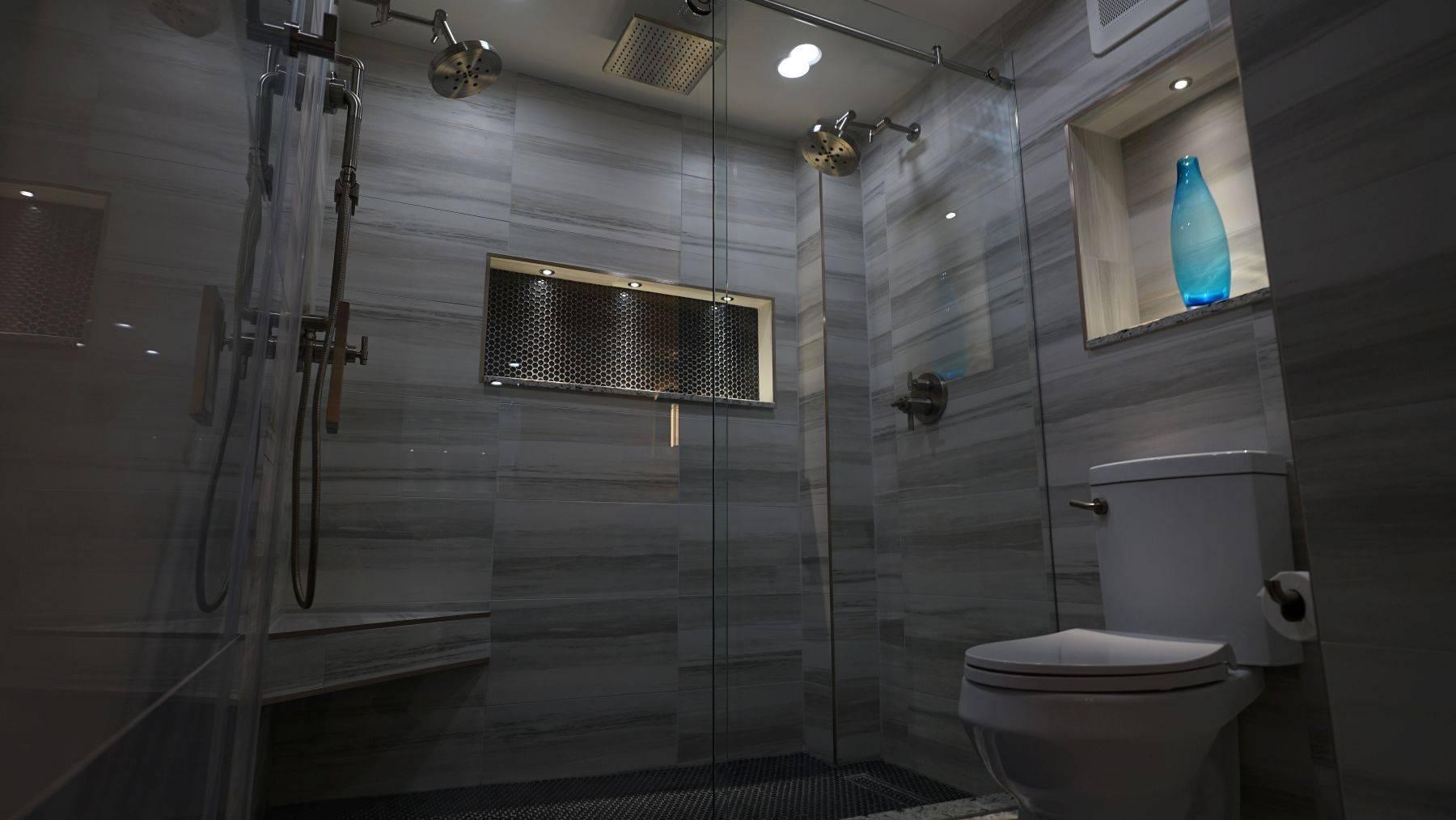 Modern floor to ceiling tiles, inset shower shelving in Bathroom Renovation in Plantation, Florida