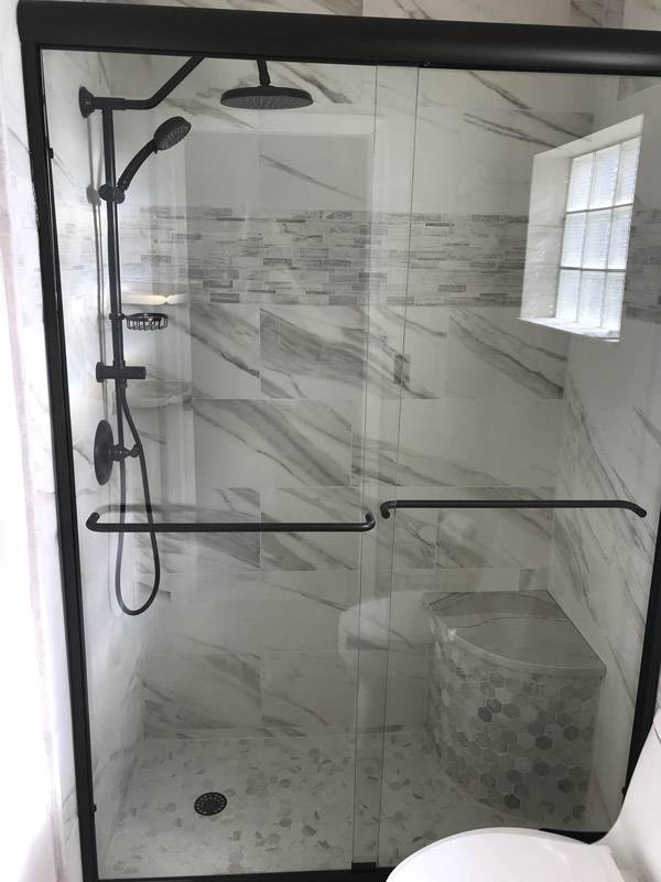 Bathroom Renovation in Fort Lauderdale, FL, for walk in shower, seat in shower, and black fixtures and accents