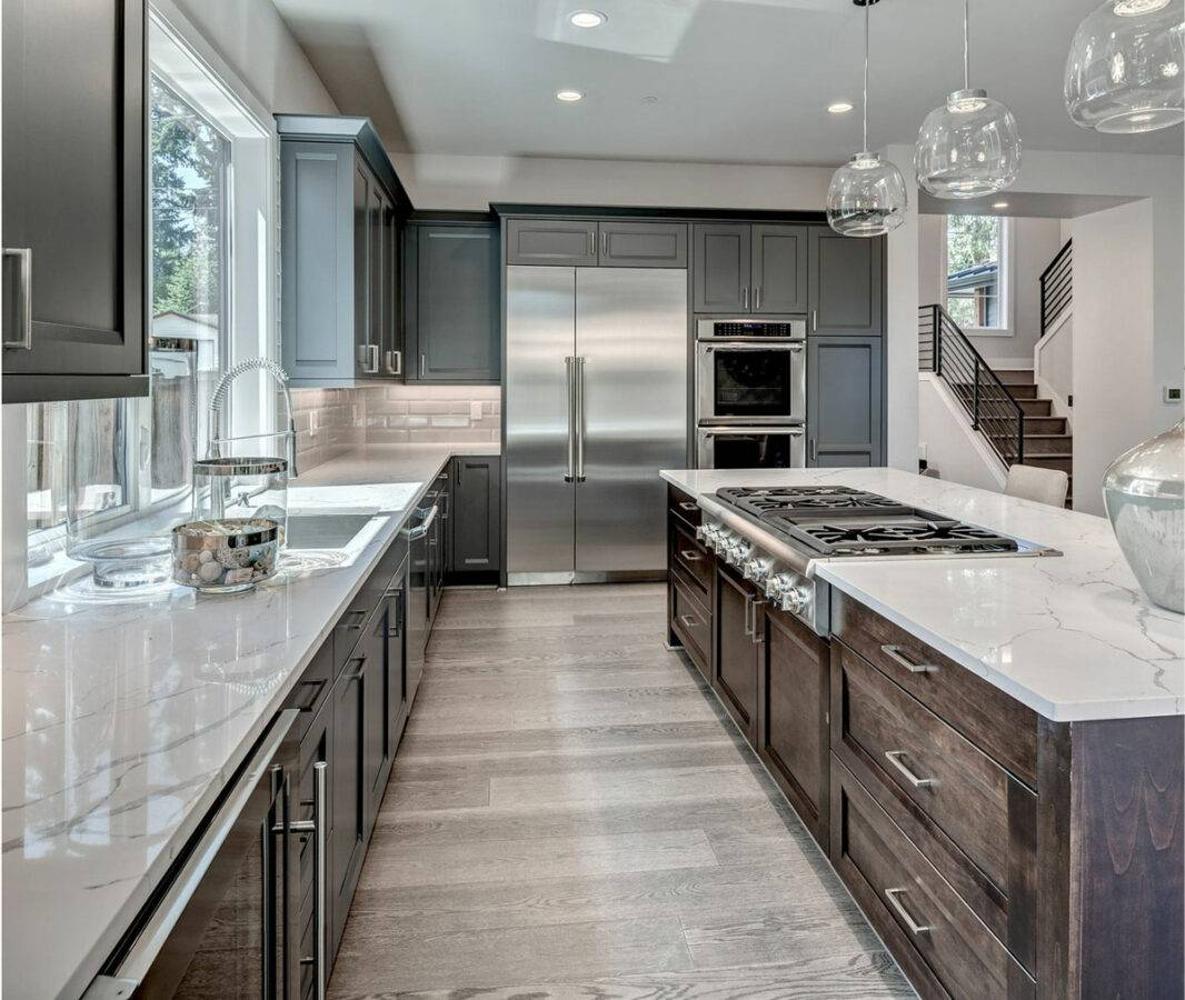 Kitchen remodeling Plantation, FL, home with gray cabinet feature, marble countertops, and stainless steel appliances