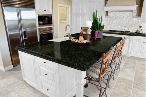Kitchen remodeling process in Coral Springs featuring black countertops with white cabinets
